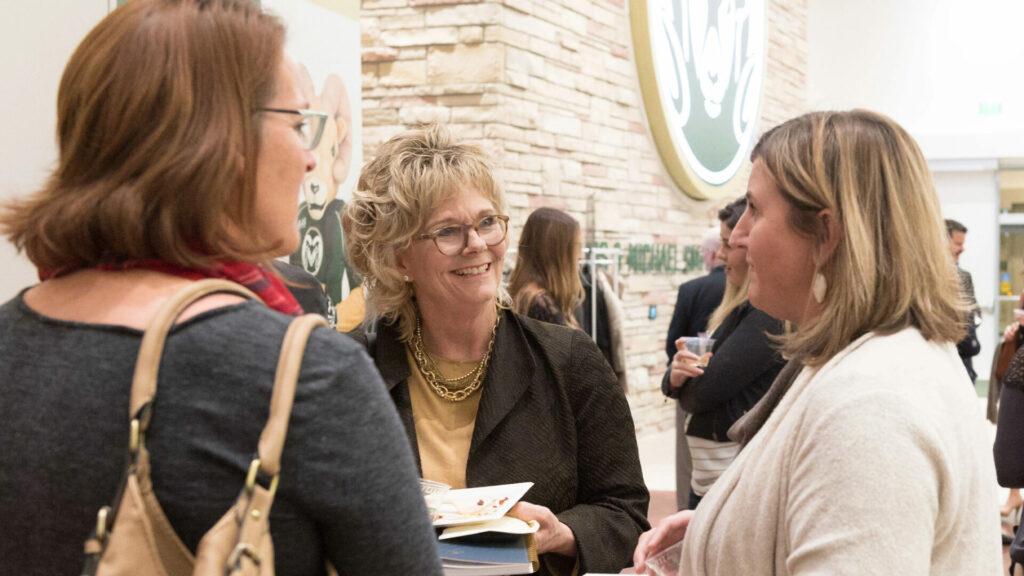 Women gathering at Smith Alumni Center